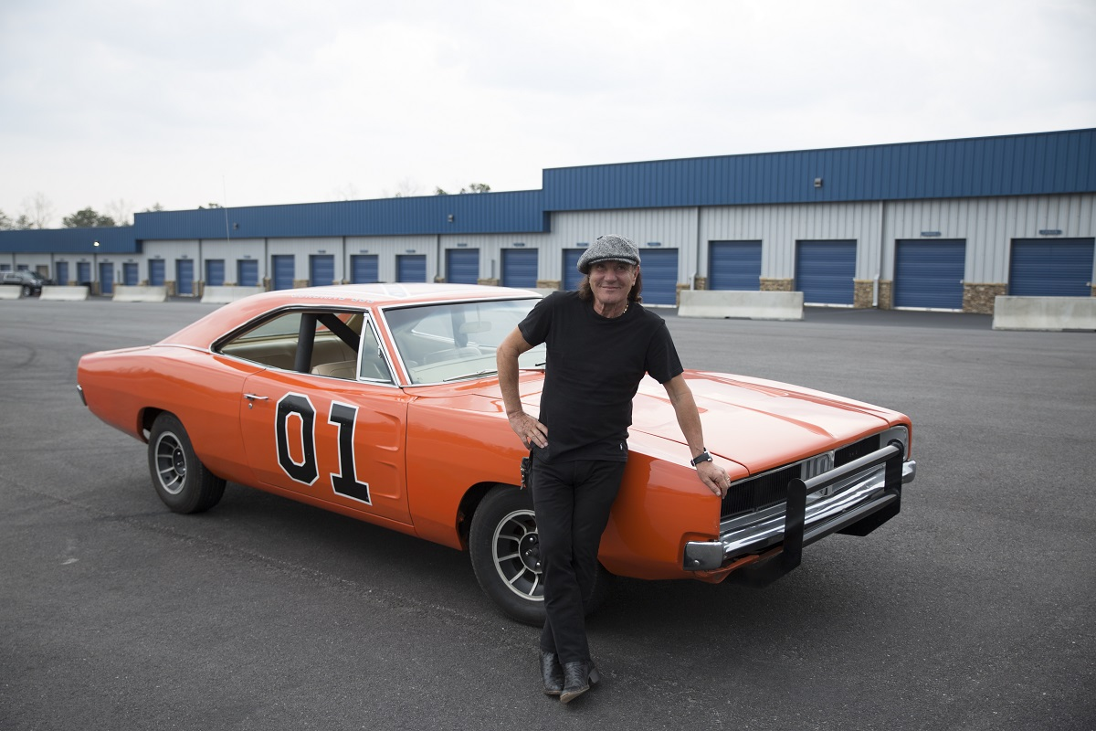 Ep2 - Brian Johnson standing by one of the remaning 12 original & infamous Dukes of Hazzard Dodge Chargers.