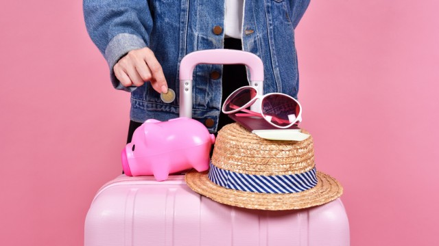 Money cash saving for travel concept, Traveler and pink suitcase, Passenger and passport document over pink background.